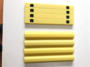 Backhoe loader wear pad